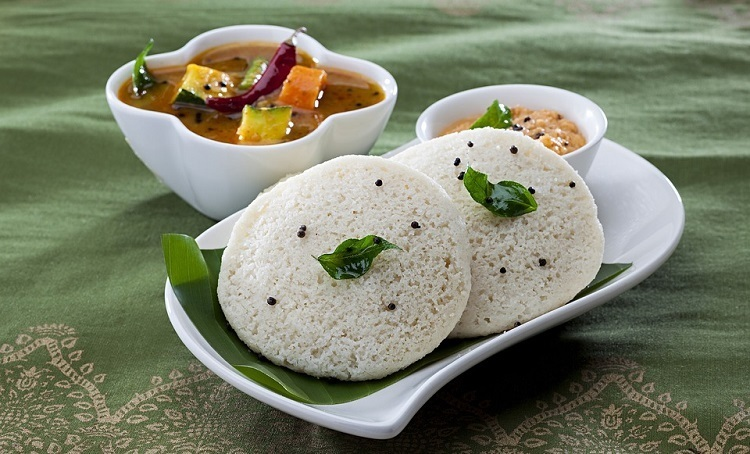 Idli Sambar with coconut chuteny Served in a Plate