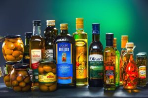 Olive oil of different brands packed in variety of bottels