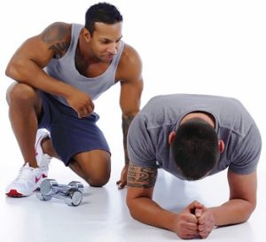 Personal trainer coaching the persong working out