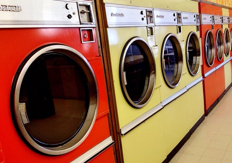 Washing machine and dryer arranged in a line